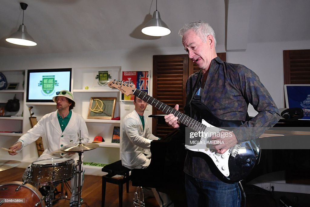 Former US tennis player John McEnroe plays guitar during an event in Paris on May 27, 2016 organised by the 'We Are Tennis Fan Academy 2016' to train fans before they attend matches at the Roland Garros 2016 French Tennis Open. / AFP / MIGUEL