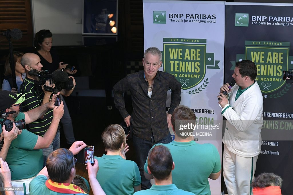Former US tennis player John McEnroe (C) speaks to fans at an event in Paris on May 27, 2016 organised by the 'We Are Tennis Fan Academy 2016' to train fans before they attend matches at the Roland Garros 2016 French Tennis Open. / AFP / MIGUEL