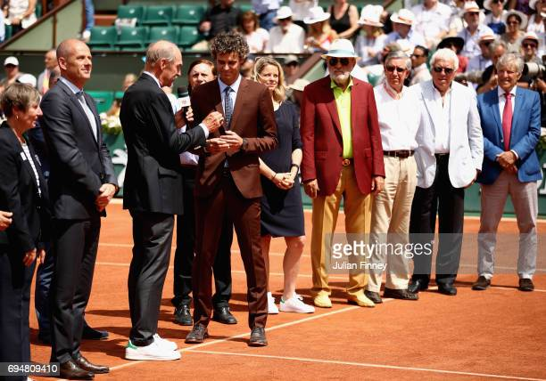 Former US tennis player Stan Smith gives the Hall of fame ring to former Brazilian tennis player Gustavo Kuerten during a ceremony marking 20 year...