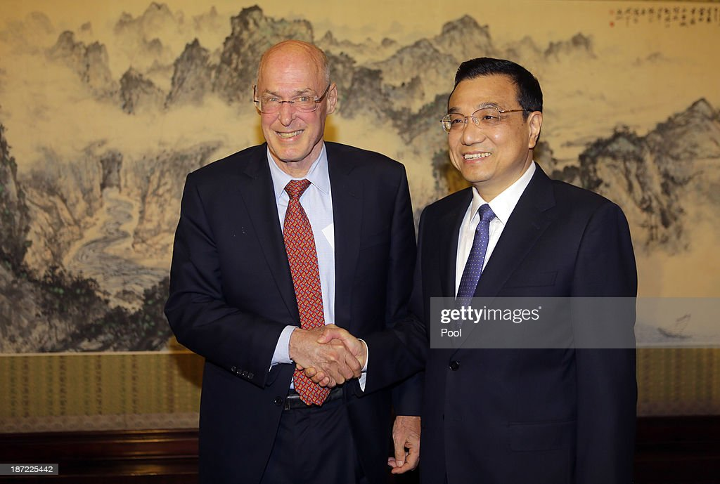 Former U.S. Treasury Secretary Henry Paulson (L) shakes hands with China's Premier <a gi-track='captionPersonalityLinkClicked' href=/galleries/search?phrase=Li+Keqiang&family=editorial&specificpeople=2481781 ng-click='$event.stopPropagation()'>Li Keqiang</a> during a meeting at the Zhongnanhai compound on November 7, 2013 in Beijing, China.