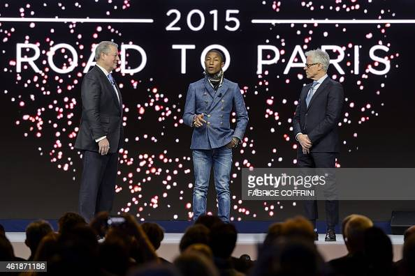 Former US Vice President Al Gore and Live Earth founder Kevin Wall listen to US singer Pharrell Williams during a session of the World Economic Forum...