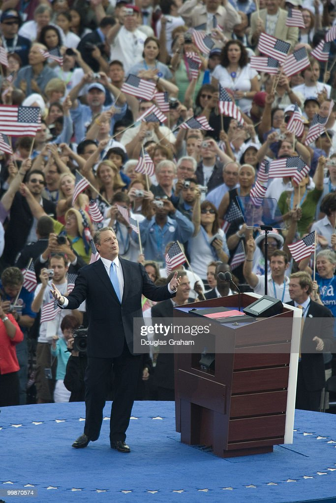 Former US Vice President Al Gore greets the crowd before giving his speech on day four of the Democratic National Convention at Invesco Field at Mile...