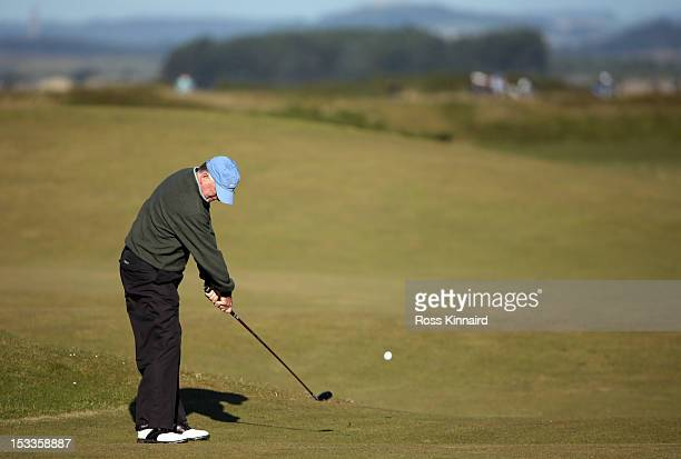 Former US Vice President Dan Quayle plays his second shot on the fourth hole during the first round of The Alfred Dunhill Links Championship at The...