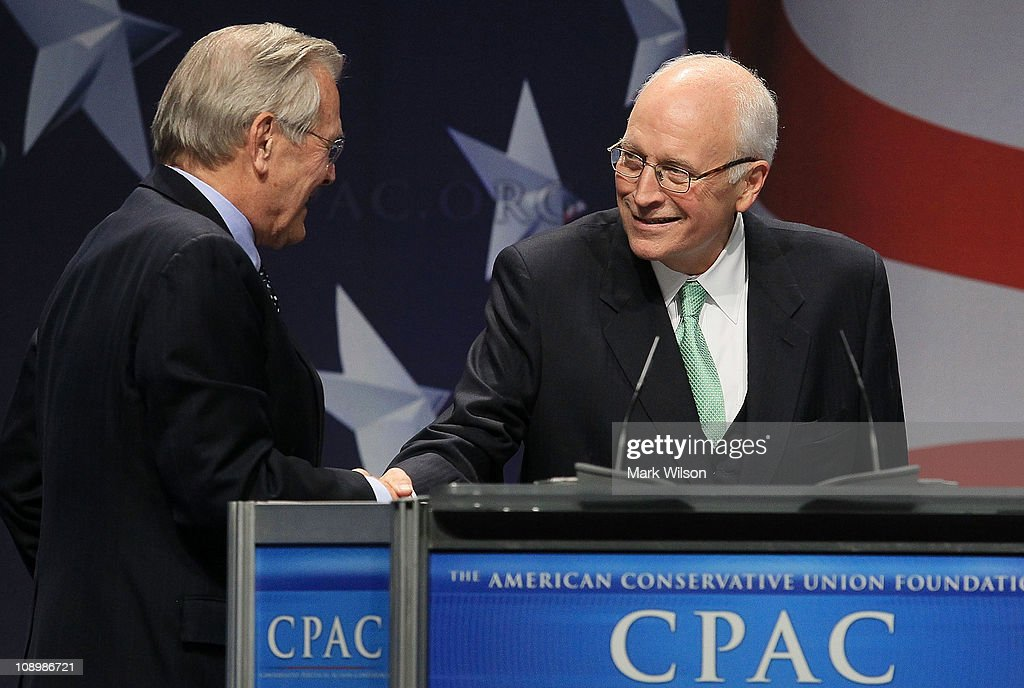 Former U.S. Vice President <a gi-track='captionPersonalityLinkClicked' href=/galleries/search?phrase=Dick+Cheney&family=editorial&specificpeople=125149 ng-click='$event.stopPropagation()'>Dick Cheney</a> (R) introduces former U.S. Secretery of Defense <a gi-track='captionPersonalityLinkClicked' href=/galleries/search?phrase=Donald+Rumsfeld&family=editorial&specificpeople=125152 ng-click='$event.stopPropagation()'>Donald Rumsfeld</a> at the Conservative Political Action conference (CPAC), on February 10, 2011 in Washington, DC. The CPAC annual gathering is a project of the American Conservative Union.
