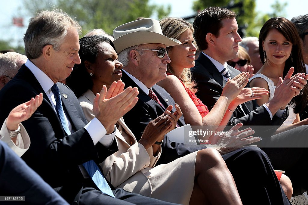 Former U.S. Vice President Dick Cheney (3rd L) is acknowledged as (L-R) Former British Prime Minister Tony Blair, former U.S. Secretary of State Condoleezza Rice, George W. Bush's daughter Jenna Bush Hager, her husband Henry Hager, and sister Barbara Bush applaud during the opening ceremony of the George W. Bush Presidential Center April 25, 2013 in Dallas, Texas. The Bush library, which is located on the campus of Southern Methodist University, with more than 70 million pages of paper records, 43,000 artifacts, 200 million emails and four million digital photographs, will be opened to the public on May 1, 2013. The library is the 13th presidential library in the National Archives and Records Administration system.
