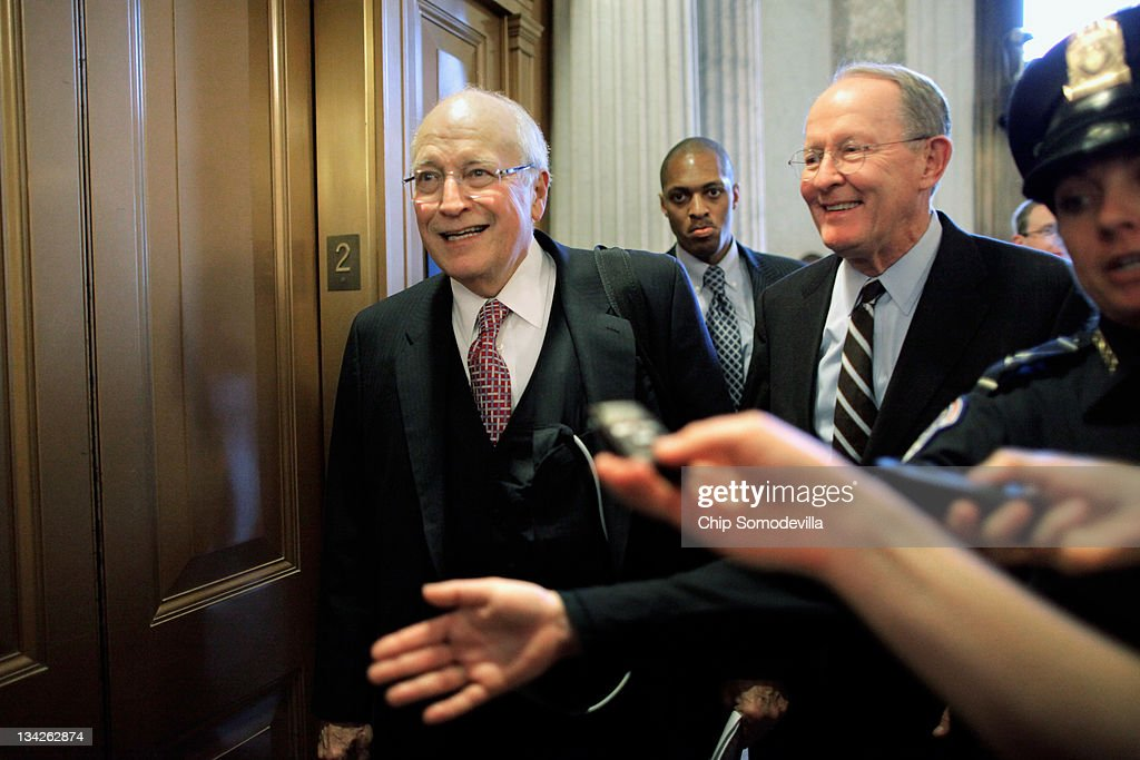 Former U.S. Vice President Dick Cheney (L) leaves the Senate Republican policy luncheon with Sen. Lamar Alexander (R-TN) (R) at the U.S. Capitol November 29, 2011 in Washington, DC. The Senate Democratic and Republican caucuses met separately behind closed doors to discuss the annual $226 billion Defense Authorization legislation. The White House has threatened to veto the military spending bill over parts of the bill requiring that al-Qaeda members captured on US soil be held by the military and not civilian authorties. Senate Armed Services Committee ranking member Sen. John McCain (R-AZ) said there was a robust debate on the detainee issue during the GOP luncheon, but Cheney did not join the discussion.