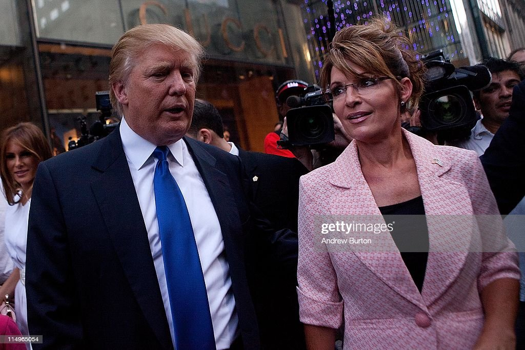 Former U.S. Vice presidential candidate and Alaska Governor <a gi-track='captionPersonalityLinkClicked' href=/galleries/search?phrase=Sarah+Palin&family=editorial&specificpeople=4170348 ng-click='$event.stopPropagation()'>Sarah Palin</a> (R), and <a gi-track='captionPersonalityLinkClicked' href=/galleries/search?phrase=Donald+Trump+-+Born+1946&family=editorial&specificpeople=118600 ng-click='$event.stopPropagation()'>Donald Trump</a> walk towards a limo after leaving Trump Tower, at 56th Street and 5th Avenue, on May 31, 2011 in New York City. Palin and Trump met for a dinner meeting in the city.