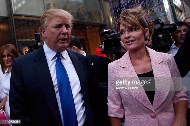 Former US Vice presidential candidate and Alaska Governor Sarah Palin and Donald Trump walk towards a limo after leaving Trump Tower at 56th Street...
