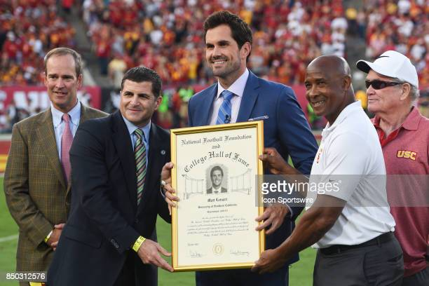 Former USC Trojan quarterback Matt Leinart being honored as a member of the College Football Hall of Fame with USC Athletic Direction Lynn Swann...