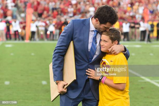 Former USC Trojan quarterback Matt Leinart hugs his son Cole after being honored as a member of the College Football Hall of Fame during a college...