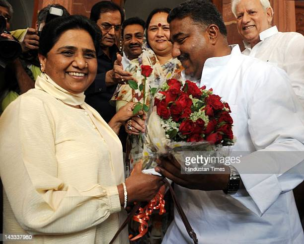 Former Uttar Pradesh chief minister and newly elected member Mayawati welcomed by her party leaders at Parliament house during the first day of the...