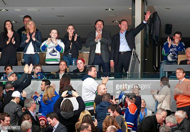 Former Vancouver Canuck Pavel Bure standing beside team owner Francesco Aquilini is saluted by the fans during the NHL game against the Edmonton...