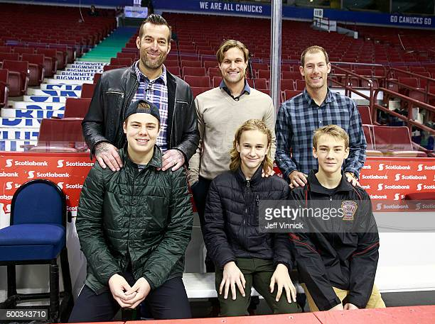 Former Vancouver Canuck players Todd Bertuzzi Markus Naslund and Brendan Morrison stand behind their sons Tag Bertuzzi Alex Naslund and Brayden...