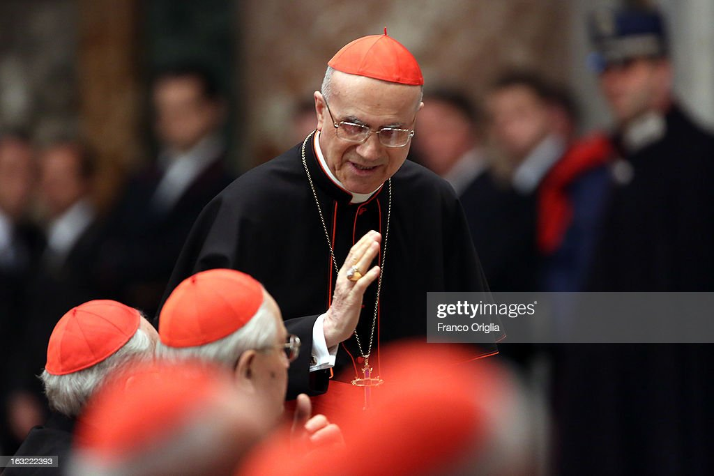 Former Vatican Secretary of State cardinal Tarcisio Bertone attends a meeting of prayer at St Peter's Basilica with cardinals gathered in Rome for...