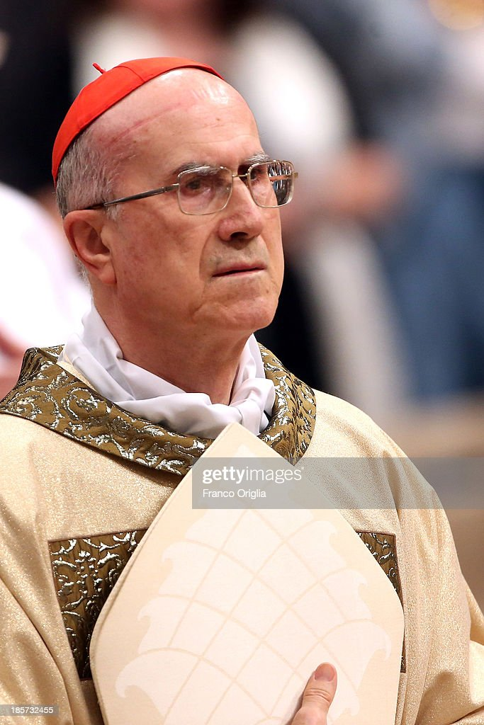 Former Vatican secretary of State cardinal <a gi-track='captionPersonalityLinkClicked' href=/galleries/search?phrase=Tarcisio+Bertone&family=editorial&specificpeople=549351 ng-click='$event.stopPropagation()'>Tarcisio Bertone</a> attends the episcopal ordination conferred by Pope Francis at St. Peter's Basilica during on October 24, 2013 in Vatican City, Vatican. Pope Francis consecrated two new Archbishops in St. Peter's Basilica. The two new Archbishops are both Papal Nuncios. French Archbishop Jean-Marie Speich was named Apostolic Nuncio to Ghana in August, while Italian Archbishop Giampiero Gloder was in September named the President of the Pontifical Ecclesiastical Academy, which is dedicated to the training of the priests who will serve in the Diplomatic Corps of the Holy See. Pontiff reminded the new Archbishops that their new position is one of service, not honour.