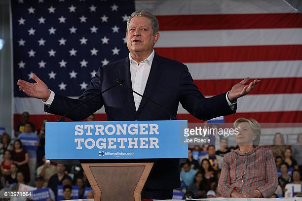 Former Vice President Al Gore speaks as Democratic presidential nominee former Secretary of State Hillary Clinton listens as they campaign together...