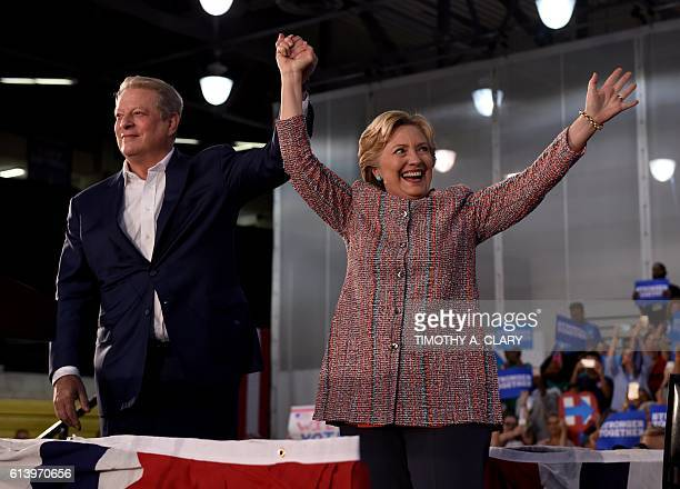 Former Vice President Al Gore waves with Democratic presidential nominee Hillary Clinton during a climate change event at Miami Dade CollegeKendall...