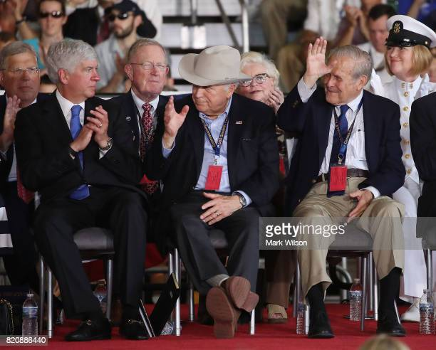 Former Vice President Dick Cheney and former Secretary of Defense Donald Rumsfeld are acknowledged during the commissioning of the USS Gerald R Ford...
