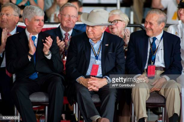 Former Vice President Dick Cheney and former US Secretary of Defense Donald Rumsfeld listen as US President Donald Trump speaks during the...