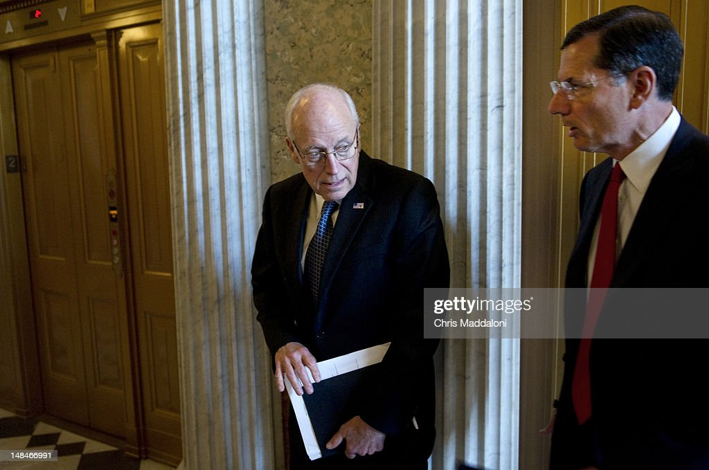 Former Vice President Dick Cheney arrives with Sen. John Barrasso, R-Wyo., at the weekly Senate policy luncheons. Democrats are struggling against GOP opposition to campaign finance reform - the GOP prevented the Disclose Act from coming to the Senate floor.