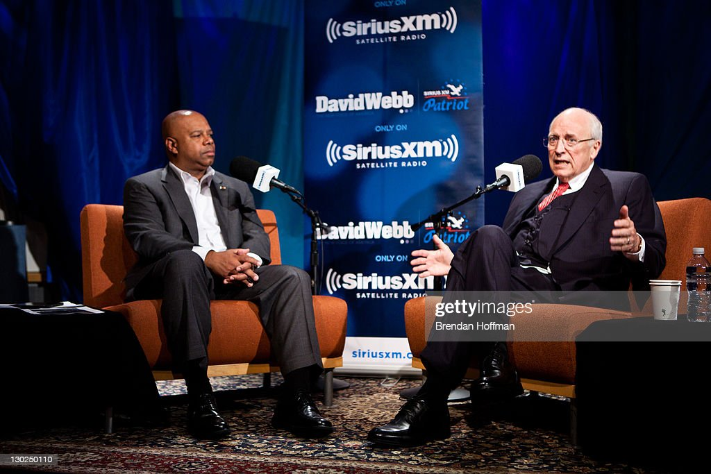 Former Vice President <a gi-track='captionPersonalityLinkClicked' href=/galleries/search?phrase=Dick+Cheney&family=editorial&specificpeople=125149 ng-click='$event.stopPropagation()'>Dick Cheney</a> is interviewed by SiriusXM Patriot host David Webb (L) at SiriusXM studios on October 25, 2011 in Washington, DC. Cheney recently released his memoir, 'In My Time.'