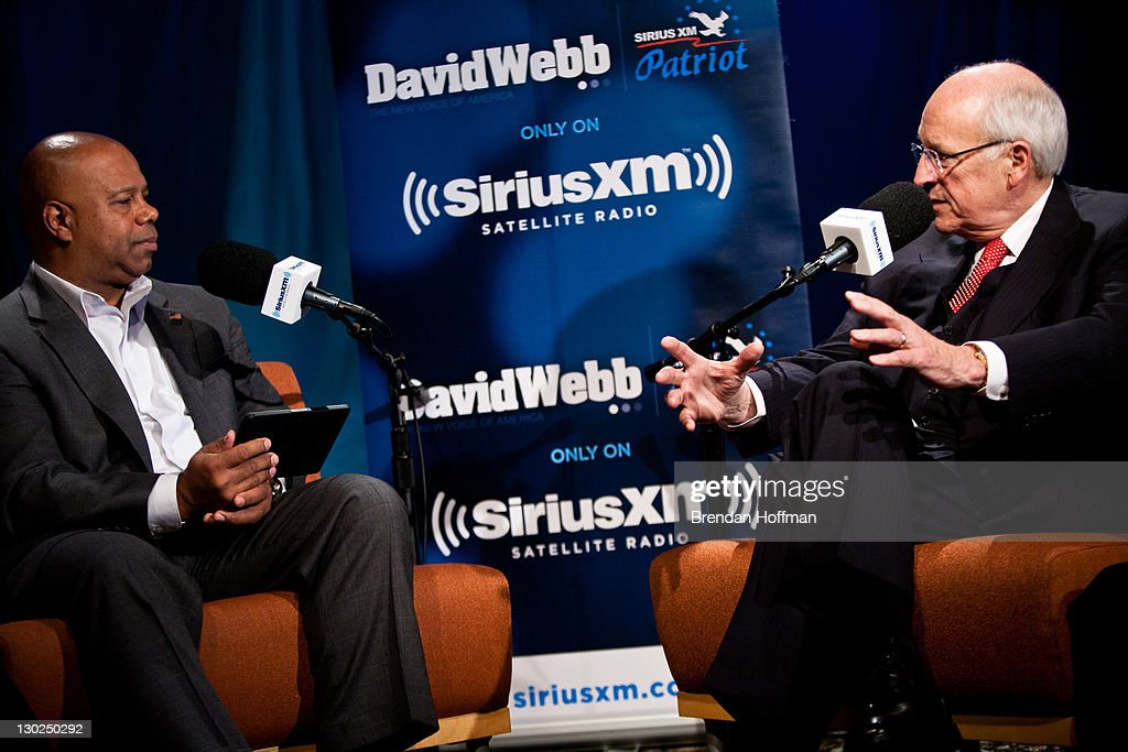 Former Vice President Dick Cheney is interviewed by SiriusXM Patriot host David Webb (L) at SiriusXM studios on October 25, 2011 in Washington, DC. Cheney recently released his memoir, 'In My Time.'