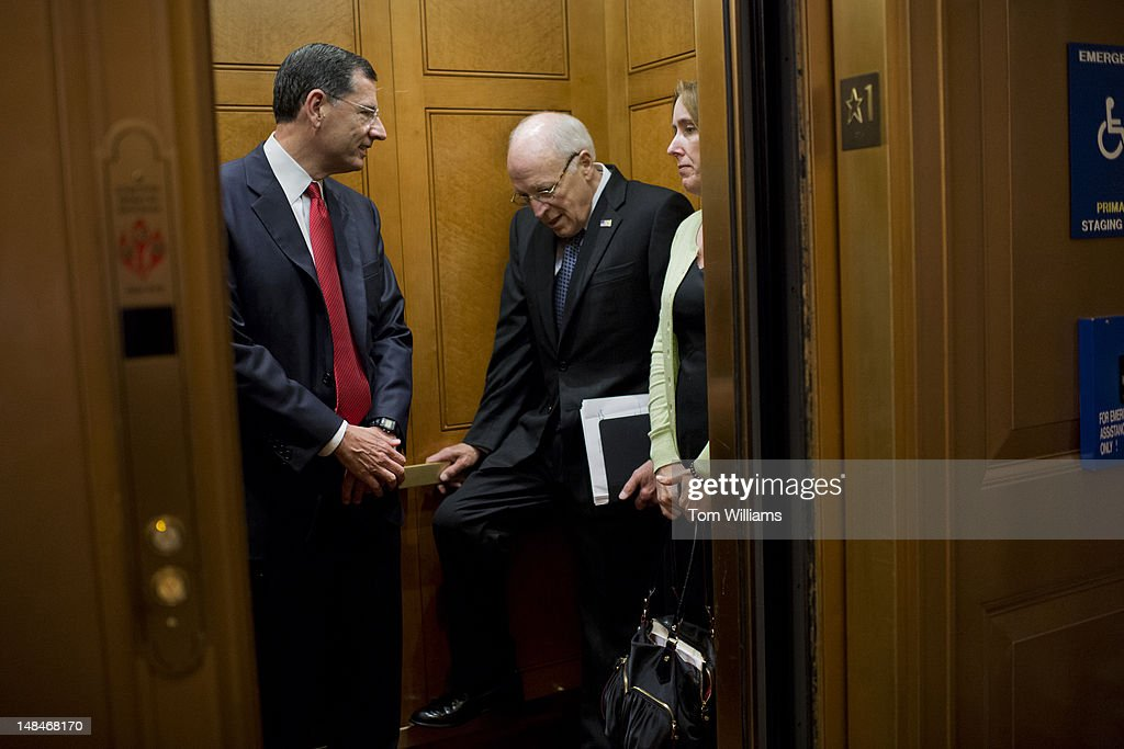 Former Vice President Dick Cheney, right, and Sen. John Barrasso, R-Wyo., make their way from the first floor of the Capitol to the senate luncheons.