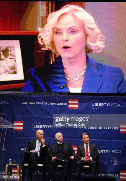 former Vice President Joe Biden Sen John McCain and National Constitution Center President and CEO Jeffrey Rosen watch a video about McCain before...