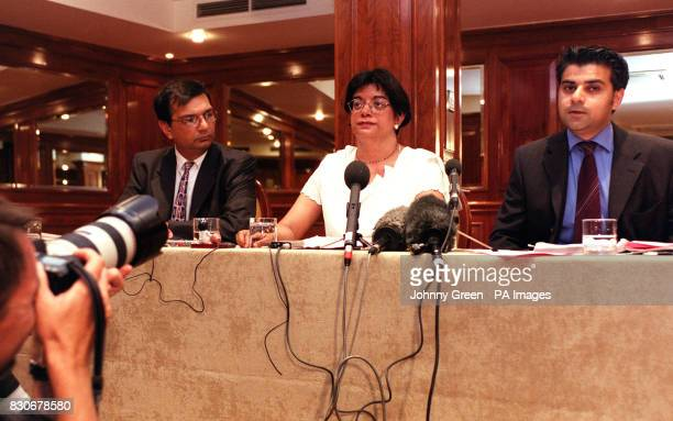 Former vice president of the Law Society Dr Kamlesh Bahl with husband Dr Nitin Lakhani and her solicitor Sadiq Khan at a press briefing in London...