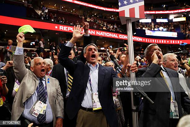 Former Virginia Attorney General Ken Cuccinelli along with other delegates from Virginia chant for a rule call vote on the first day of the...