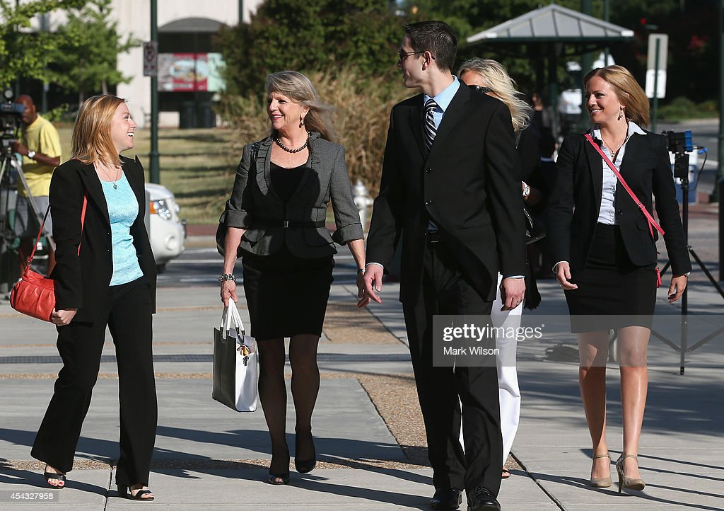 Former Virginia first lady Maureen McDonnell (R) arrives with daughters Cailin (L), Rachel (R) and her legal team for her trial at U.S. District Court August 29, 2014 in Richmond, Virginia. McDonnell and her husband, former Virginia Governor Bob McDonnell, are on trial for accepting gifts, vacations and loans from a Virginia businessman in exchange for helping his company, Star Scientific