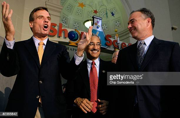 Former Virginia Gov and Democratic candidate for US Senate Mark Warner Rep Bobby Scott and Virginia Gov Tim Kaine urge on the partygoers during a...