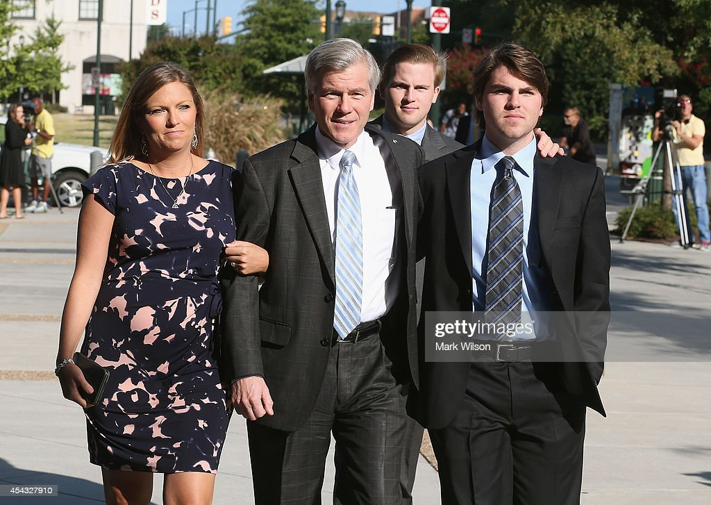 Former Virginia Governor Bob McDonnell (C) arrives for his trial at U.S. District Court with his daughter Jeanine (L) and sons Bobby (R) and Sean (2ndR), August 29, 2014 in Richmond, Virginia. McDonnell and his wife Maureen are on trial for accepting gifts, vacations and loans from a Virginia businessman in exchange for helping his company, Star Scientific.