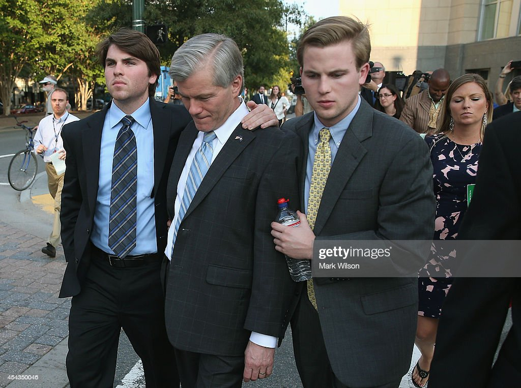 Former Virginia Governor Bob McDonnell (2ndL) is escorted by his sons Bobby (L), Sean, and daughter Jeanine (R) as he leaves his trial at U.S. District Court, August 29, 2014 in Richmond, Virginia. McDonnell and his wife Maureen are on trial for accepting gifts, vacations and loans from a Virginia businessman in exchange for helping his company, Star Scientific.