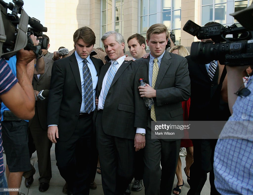 Former Virginia Governor Bob McDonnell (C) is escorted by his sons Bobby (L), Sean (R) as he leaves his trial at U.S. District Court, August 29, 2014 in Richmond, Virginia. McDonnell and his wife Maureen are on trial for accepting gifts, vacations and loans from a Virginia businessman in exchange for helping his company, Star Scientific.