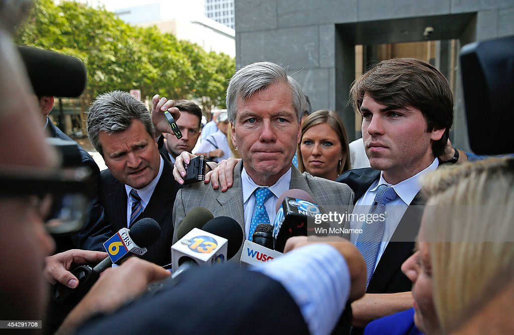 Former Virginia Governor <a gi-track='captionPersonalityLinkClicked' href=/galleries/search?phrase=Bob+McDonnell&family=editorial&specificpeople=6369061 ng-click='$event.stopPropagation()'>Bob McDonnell</a> (C) leaves his trial at U.S. District Court with his son Bobby (R) August 28, 2014 in Richmond, Virginia. McDonnell and his wife Maureen are on trial for accepting gifts, vacations and loans from a Virginia businessman in exchange for helping his company, Star Scientific.