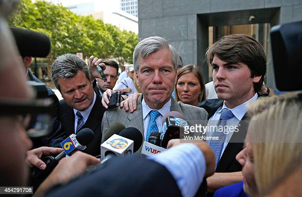 Former Virginia Governor Bob McDonnell leaves his trial at US District Court with his son Bobby August 28 2014 in Richmond Virginia McDonnell and his...