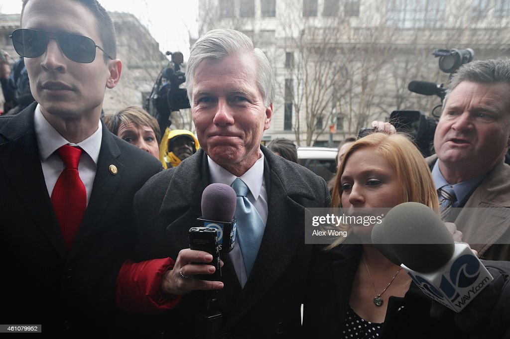 Former Virginia Governor Robert McDonnell (2nd L) arrives at U.S. District Court for the Eastern District of Virginia with his daughter Cailin Young (3rd L) and his son-in-law Chris Young (L) for his corruption trial sentencing January 6, 2015 in Richmond, Virginia. McDonnell and his wife, Maureen, were found guilty in September of multiple counts of corruption charges filed against them for receiving bribes from businessman Jonnie Williams. Maureen McDonnell will be sentenced in February.