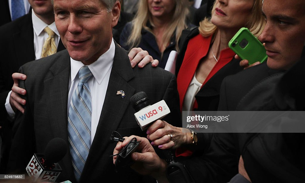 Former Virginia Governor Robert McDonnell, followed by members of the media, leaves the U.S. Supreme Court April 27, 2016 in Washington, DC. The Supreme Court heard the corruption appeal from McDonnell, who and his wife were convicted of accepting more than $175,000 of gifts and favors from businessman Jonnie Williams, who wanted their help to promote his dietary supplement product called Anatabloc.