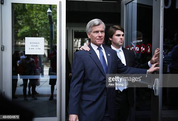 Former Virginia Governor Robert McDonnell leaves US District Court for the Eastern District of Virginia with his son Bobby after jury began their...