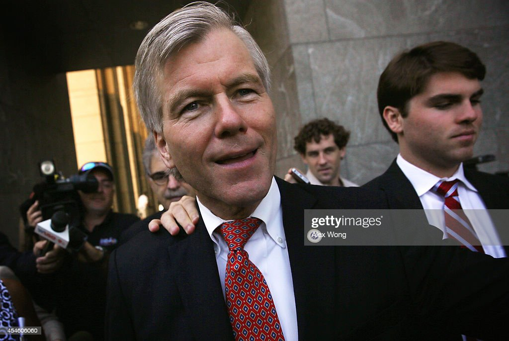 Former Virginia Governor Robert McDonnell (2nd R) leaves U.S. District Court for the Eastern District of Virginia with his son Bobby (R) on the third day of deliberations of his corruption trial September 4, 2014, in Richmond, Virginia. McDonnell and his wife Maureen are on trial for accepting gifts, vacations and loans from a Virginia businessman in exchange for helping his company.
