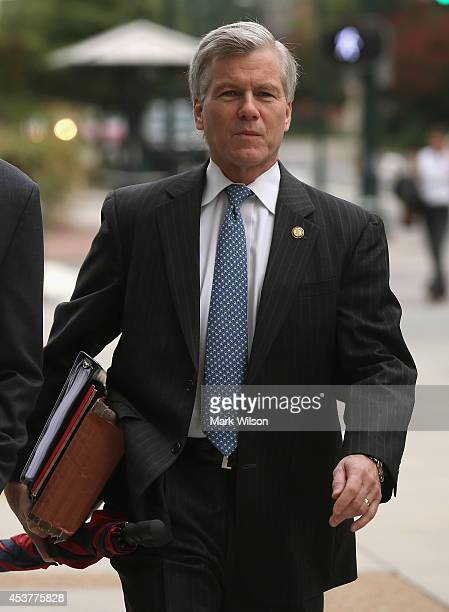 Former Virginia Governor Robert McDonnell walks to his corruption trial at US District Court for the Eastern District of Virginia August 18 2014 in...