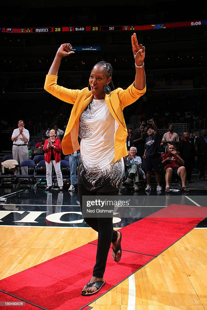 Former Washington Mystic Chamique Holdsclaw waves to the crowd during a presentation of the 15th anniversary alltime team of the Washington Mystics...