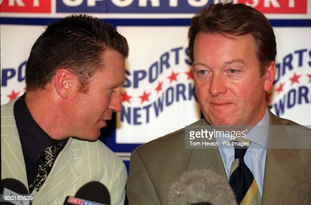 Former WBO middleweight and supermiddleweight world champion Steve Collins talks to promoter Frank Warren during a photocall at London's Park Court...