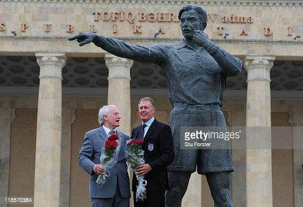 Former West Germany goalkeeper Hans Tilkowski and former England striker Sir Geoff Hurst stand next to the statue of the 1966 World Cup final...