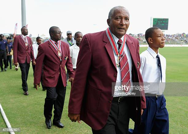 Former West Indian cricketers Andy Roberts Richie Richardson and Curtly Ambrose are paraded round the field after being awarded knighthoods during...