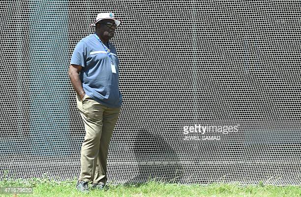Former West Indies cricketer Clive Lloyd watches West Indies cricketers during a training session at the Kensington Oval Stadium in Bridgetown on...