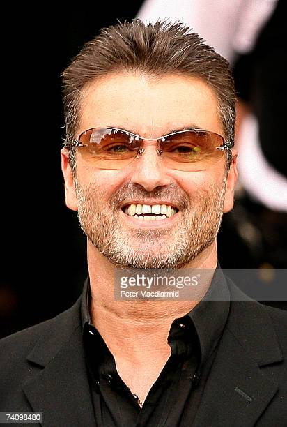 Former Wham singer George Michael leaves Brent Magistrates Court after pleading guilty to a charge of driving while unfit through drugs on May 8 2007...