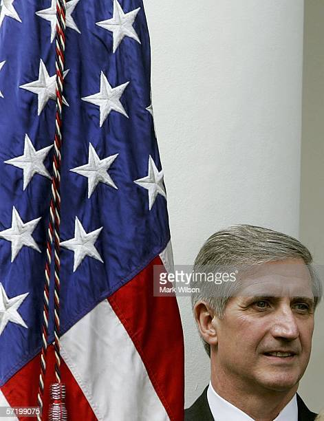 Former White House Chief of Staff Andrew Card listens to US President George W Bush speak in the Rose Garden at the White House March 28 2006 in...