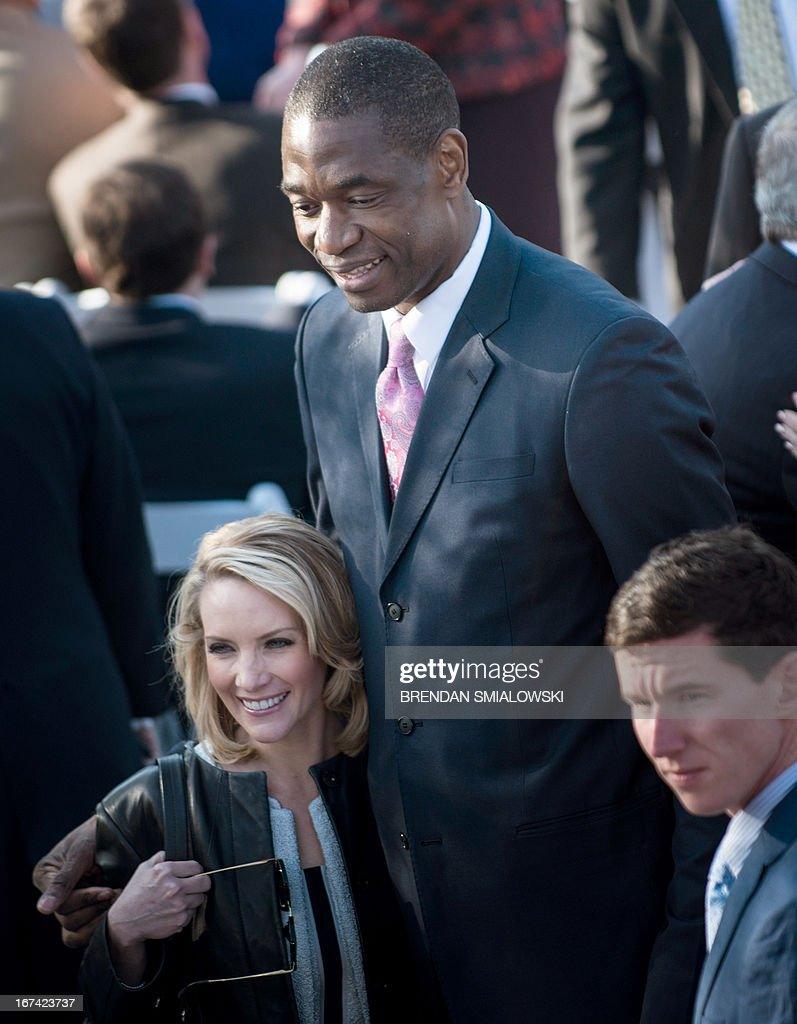 Former White House Press Secretary Dana Perino stands with former NBA Houston Rockets player Dikembe Mutombo before a dedication ceremony at the George W. Bush Library and Museum on the grounds of Southern Methodist University April 25, 2013 in Dallas, Texas. The Bush library is dedicated to chronicling the presidency of the United State's 43rd President, George W. Bush. AFP PHOTO/Brendan SMIALOWSKI